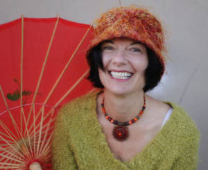 interview: Sherry Richert Belul - smiling woman in front of parasol